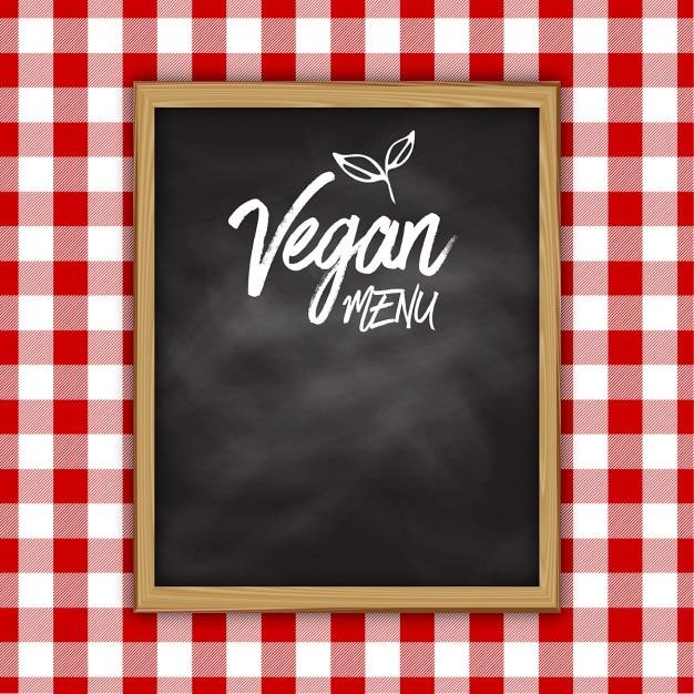 Vegan menü tafel-design auf einem karierten tuch hintergrund Kostenlosen Vektoren