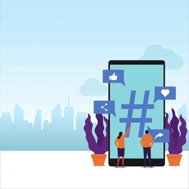 Vektor-konzeptpaare der trendthemen halten flaches telefon um großes hashtag. Premium Vektoren