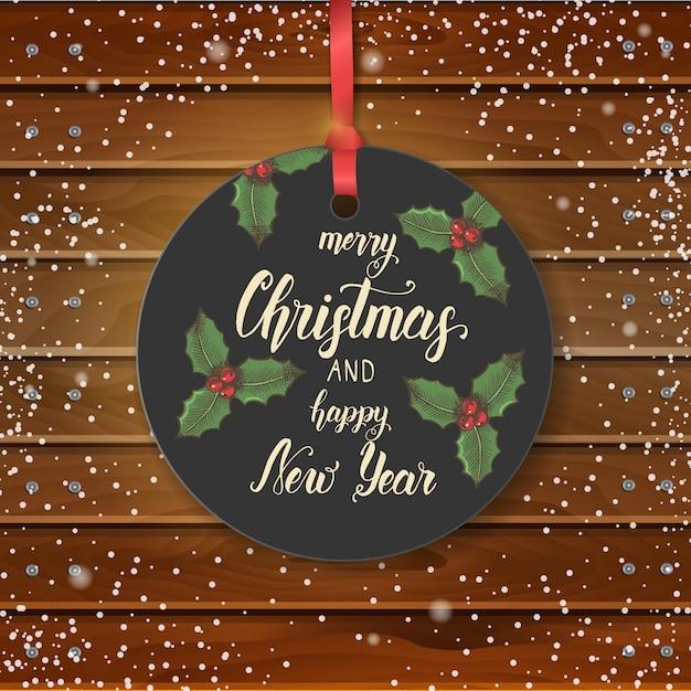 Vektor-weihnachtsweinleseaufkleber mit hand gezeichneter stechpalme und handgemachtem zitat Premium Vektoren