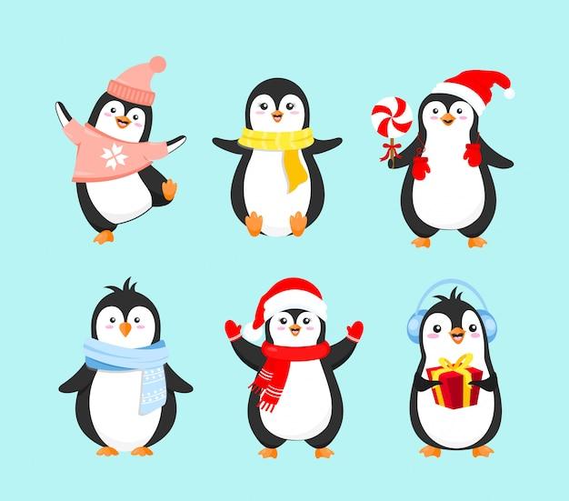 Vektorillustrationssatz der niedlichen pinguine in der winterkleidung. frohe weihnachten konzept, frohes neues jahr und winterferien. pinguinsammlung auf hellblauem hintergrund im flachen karikaturstil. Premium Vektoren