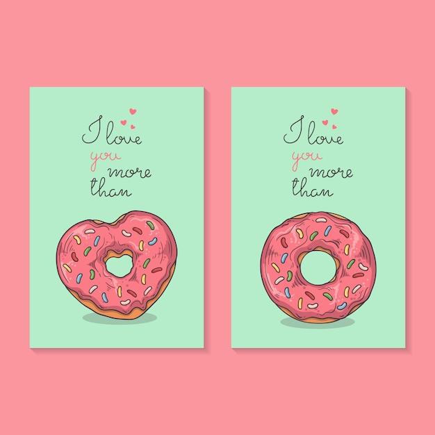 Vektorzeichnungen. herzlichen glückwunsch zum valentinstag. karten mit donuts. Premium Vektoren