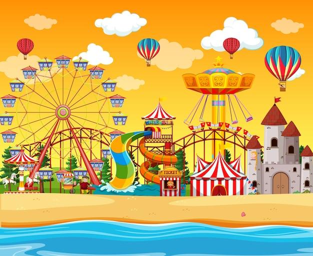 Vergnügungspark mit strandseitenszene tagsüber mit luftballons am himmel Kostenlosen Vektoren