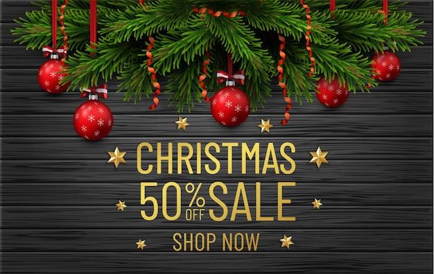 Verkaufsfahne der frohen weihnachten und des guten rutsch ins neue jahr. weihnachtsbaumgrenze mit goldenen dekorationen auf schwarzem holz Premium Vektoren