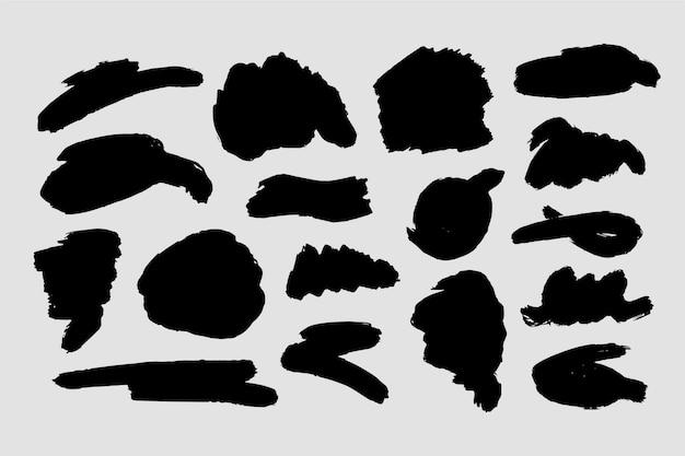 Verschiedene abstrakte formen von tintenpinselstrichen Kostenlosen Vektoren