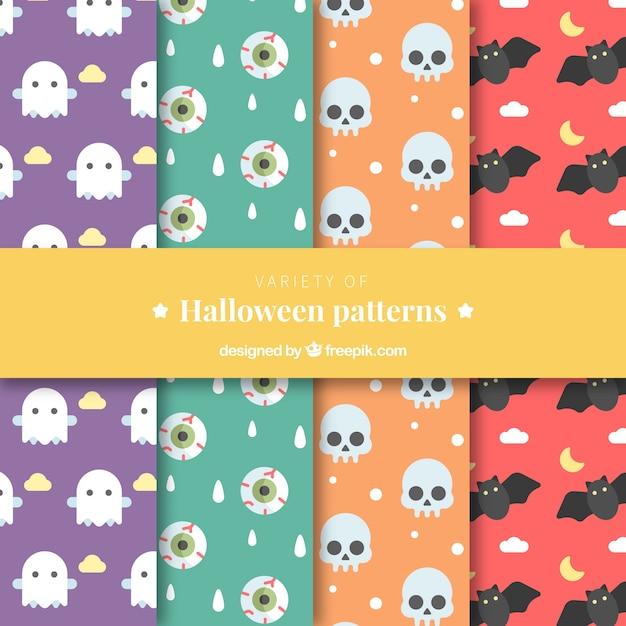 Verschiedene farbmuster mit halloween-elementen in flachem design Kostenlosen Vektoren