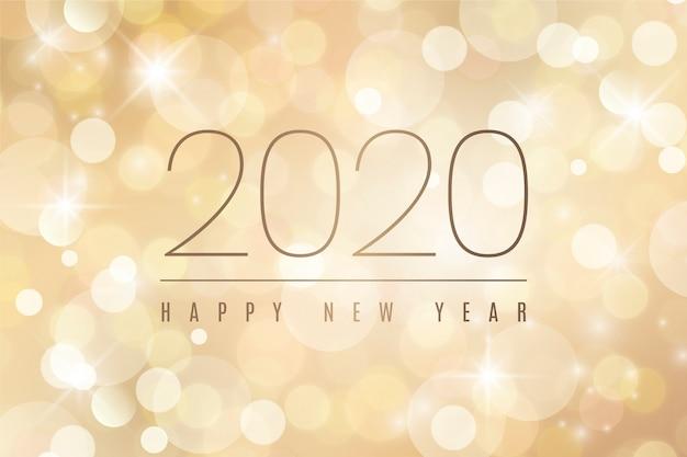 Verschwommene frohes neues jahr 2020 Kostenlosen Vektoren
