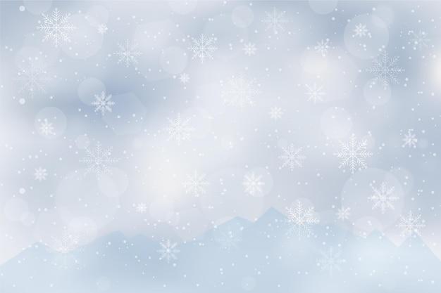 Verschwommener winterhintergrund Kostenlosen Vektoren