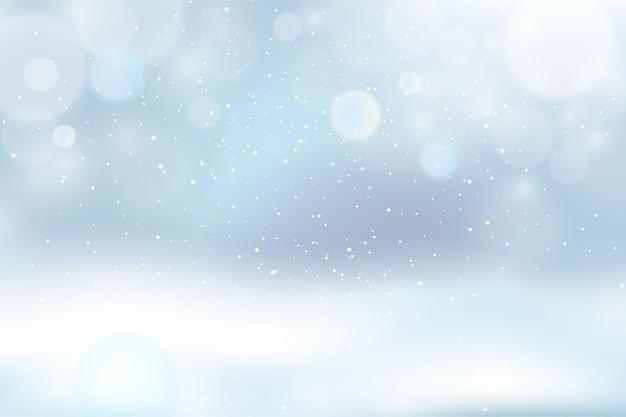 Verschwommener winterhintergrund Premium Vektoren