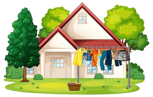 Viele kleider hängen an einer linie außerhalb der hausszene Kostenlosen Vektoren