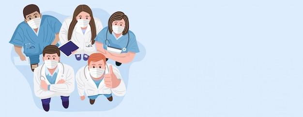 Vielen dank, dass sie ärzte und krankenschwestern konzept. draufsicht von medizinischen teams, die masken tragen und stehend in die kamera schauen. Premium Vektoren