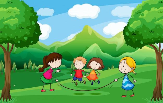 Vier kinder spielen im freien in der nähe der bäume Premium Vektoren