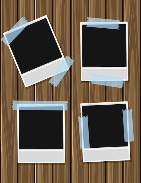 Vier leere Bilderrahmen auf Holzbrett   Download der Premium Vektor