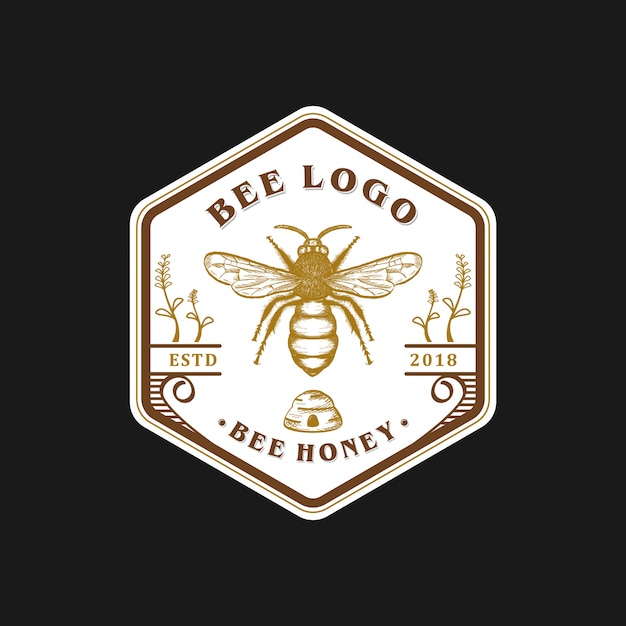 Vintage biene logo design Premium Vektoren