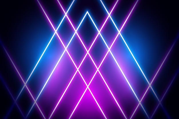 Violette und blaue neonlichter auf dunklem hintergrund Kostenlosen Vektoren