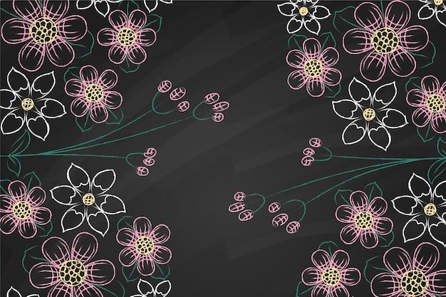 Violette und weiße blumen auf tafelhintergrund Kostenlosen Vektoren