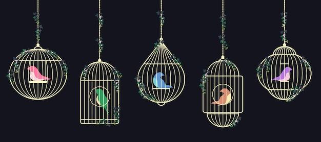 Vögel in goldenen käfigen. Premium Vektoren