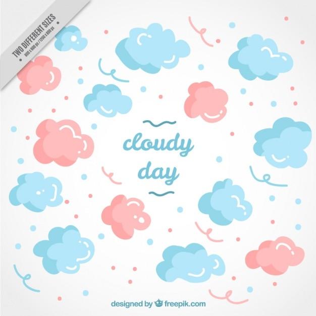 Von hand gezeichnet hintergrund der rosa und blauen wolken Kostenlosen Vektoren