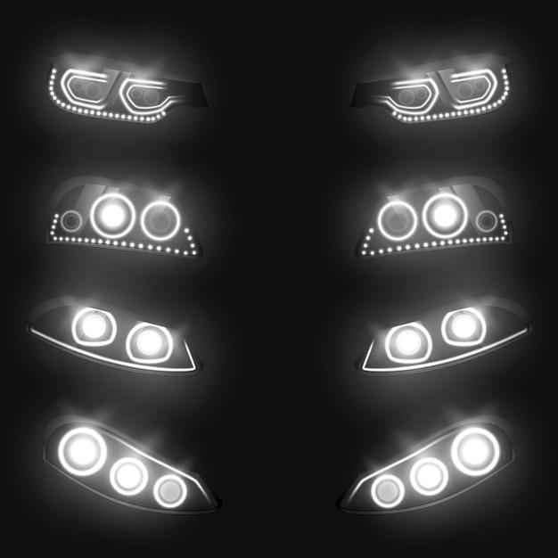 Vordere und hintere scheinwerfer des autos, die im realistischen satz der dunkelheit lokalisiert auf schwarzem hintergrund weiß glühen. Kostenlosen Vektoren