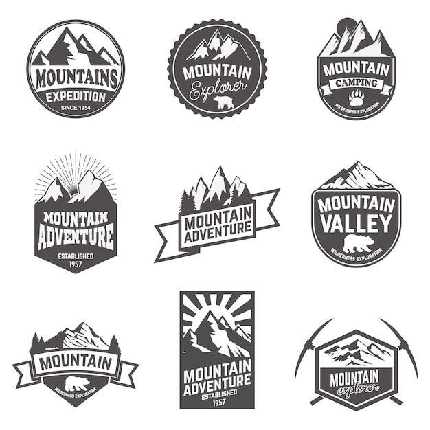 Wandern, bergforschungsetiketten und embleme. Premium Vektoren