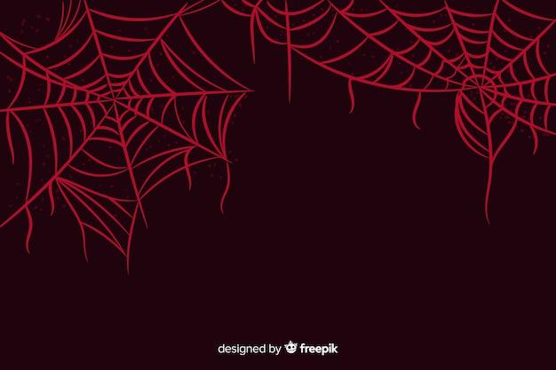 Web-halloween-hintergrund der spinne roter Kostenlosen Vektoren