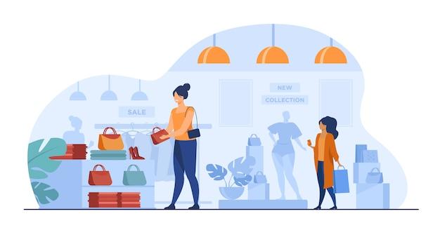 Weibliche kunden, die im bekleidungsgeschäft einkaufen Kostenlosen Vektoren