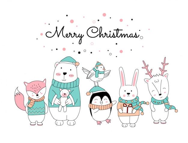 Weihnachten mit der niedlichen tierkarikaturstellung Premium Vektoren