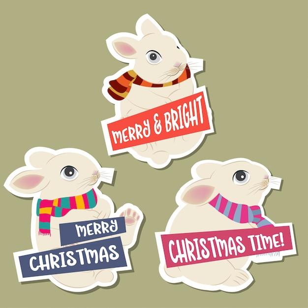 Weihnachtsaufkleberansammlung mit kaninchen und wünschen. flaches design. vektor Premium Vektoren