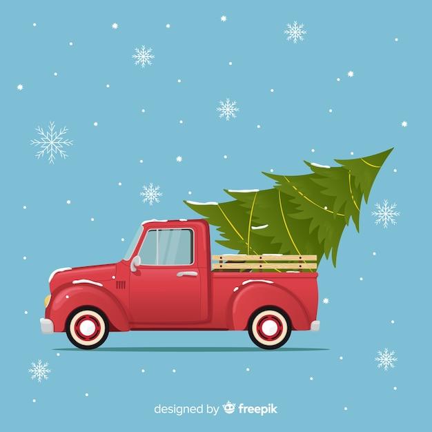 Weihnachtsbaum auf einem pickup-truc Kostenlosen Vektoren