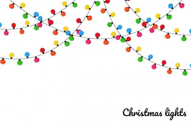 Weihnachtsbeleuchtung. bunte dekorative birnen für dekoration an einem weihnachtsfest. Premium Vektoren