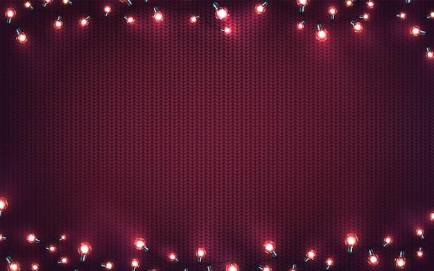 Weihnachtsbeleuchtung. weihnachtsglühende girlanden von led-glühlampen auf purpur strickten beschaffenheit. feiertagshintergrund Premium Vektoren