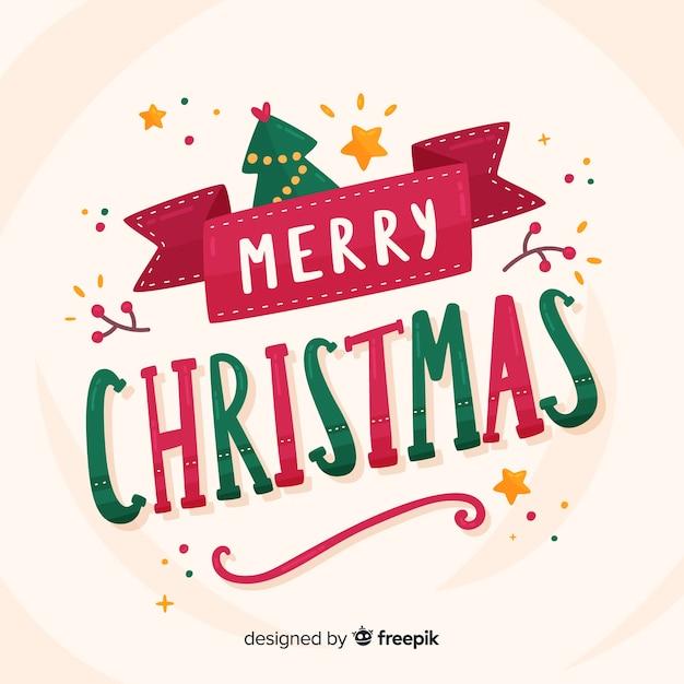 Weihnachtsbeschriftung mit baum und sternen Kostenlosen Vektoren