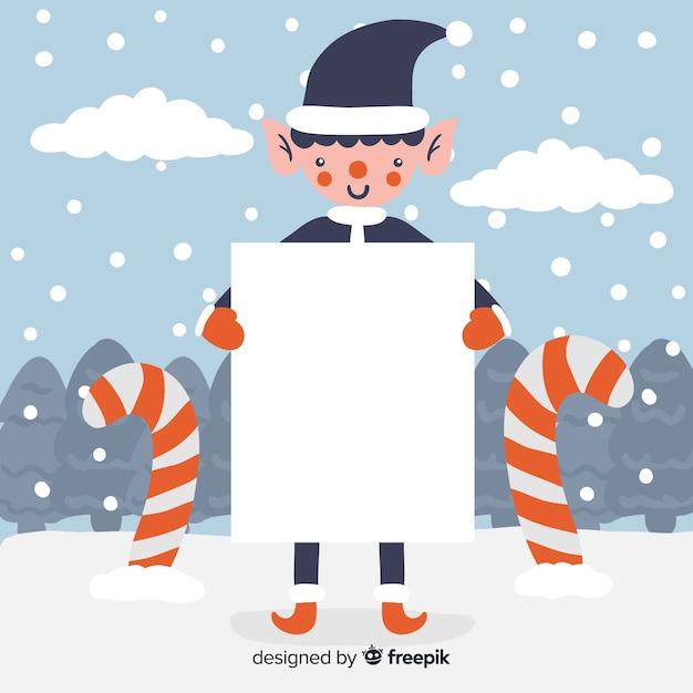 Weihnachtscharakter, der weiße leere karte anhält Kostenlosen Vektoren