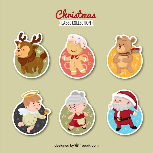 Weihnachtsetikettensammlung mit hauptweihnachtcharakteren Kostenlosen Vektoren