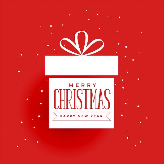 Weihnachtsgeschenk auf rotem hintergrund Kostenlosen Vektoren