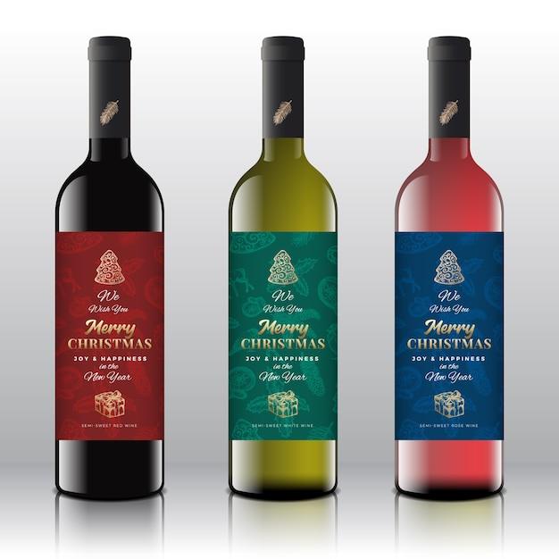 Weihnachtsgrüße weinflaschenetiketten-konzept. Premium Vektoren