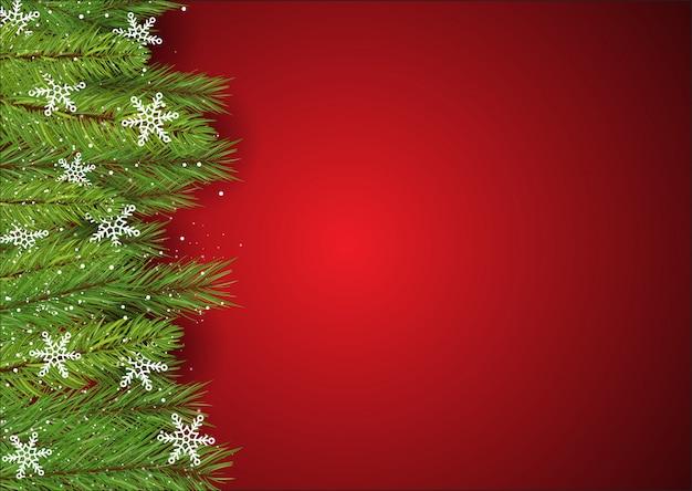 Weihnachtshintergrund mit kieferniederlassungen und -schneeflocken Kostenlosen Vektoren