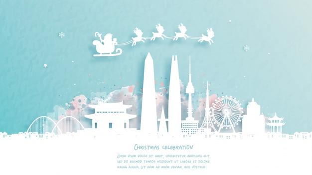 Weihnachtskarte mit reise nach seoul, südkorea konzept. netter weihnachtsmann und rentier. weltberühmtes wahrzeichen in papierschnittartillustration. Premium Vektoren