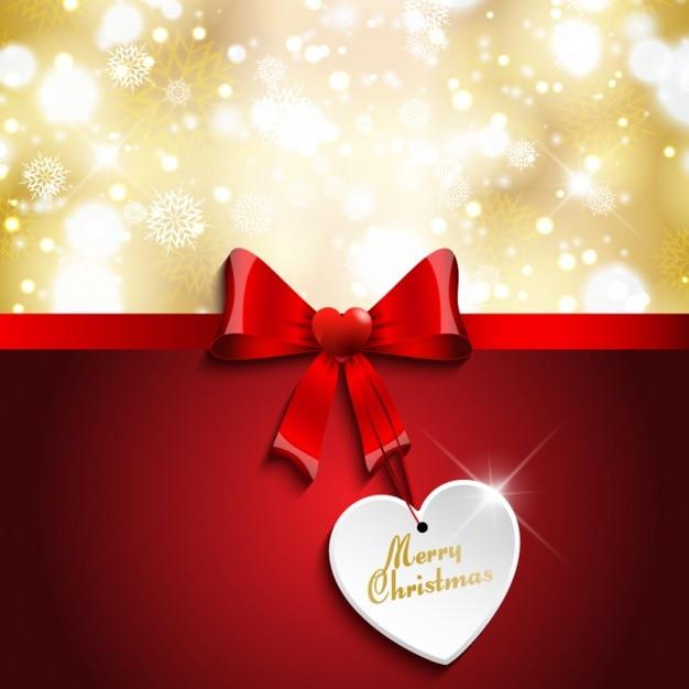 Weihnachtskarte mit roter schleife Kostenlosen Vektoren