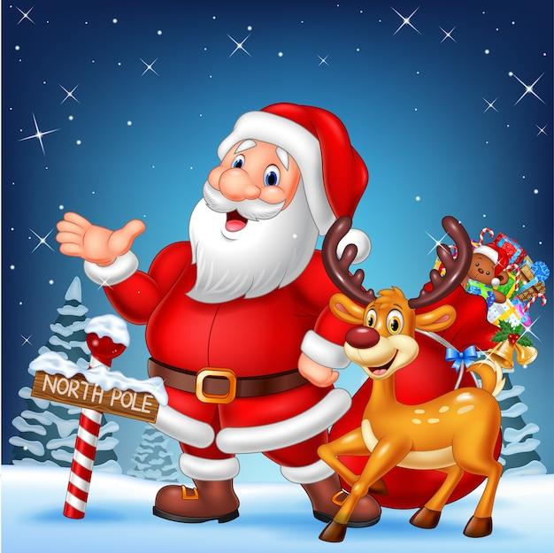 Weihnachtskarte mit santa und seinem rentier Premium Vektoren