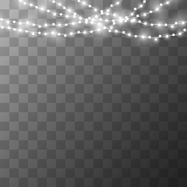 Weihnachtslichter auf einem schönen transparenten hintergrund. Premium Vektoren