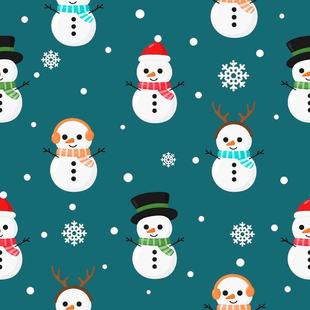 Weihnachtsnahtloses muster mit dem schneemann getrennt auf blau Premium Vektoren