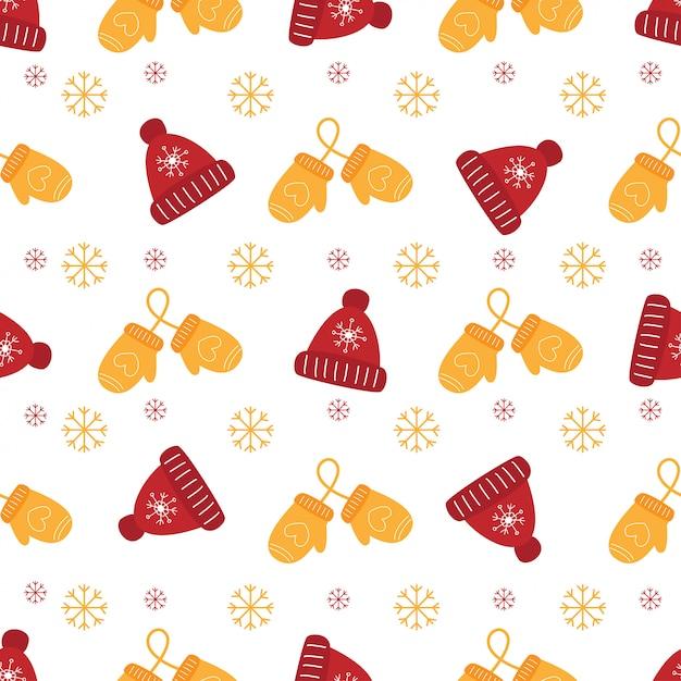 Weihnachtsnahtloses muster mit handschuhen und wintermütze. Premium Vektoren