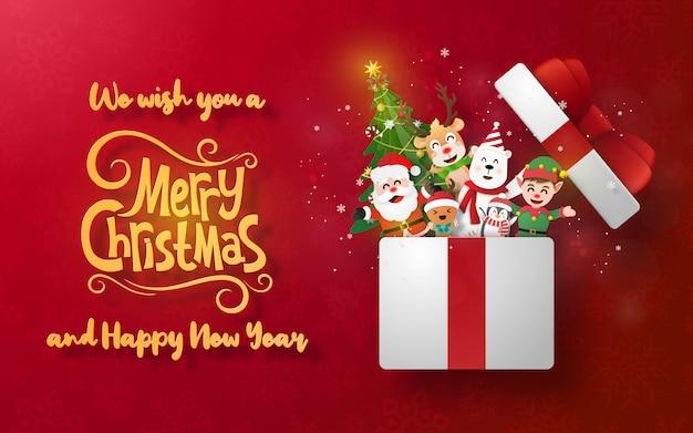 Weihnachtspostkartenfahne mit santa claus und nettem charakter in einer geschenkbox Premium Vektoren