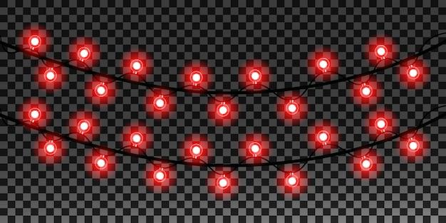 Weihnachtsrealistische lichter auf transparentem hintergrund Premium Vektoren