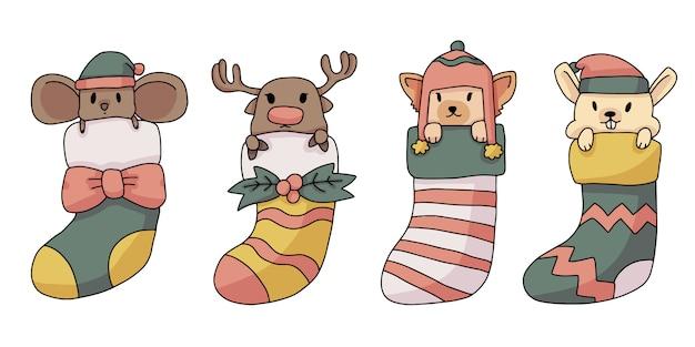 Weihnachtsren, ratte, katze und häschen innerhalb der netten illustration der socken Premium Vektoren