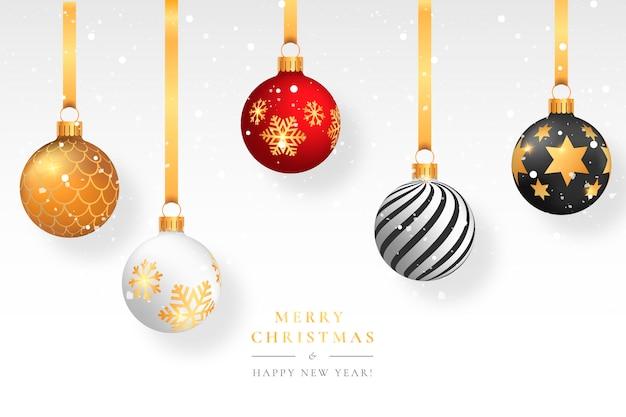 Weihnachtsschnee-hintergrund mit eleganten bällen Kostenlosen Vektoren