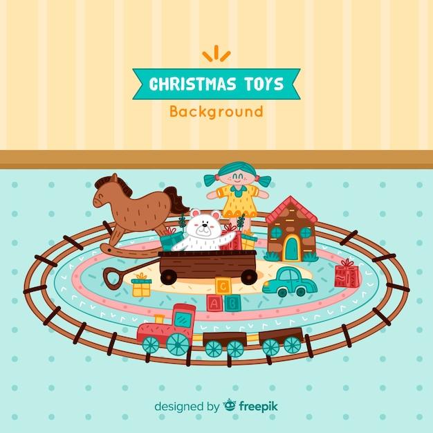 Weihnachtsspielwaren auf teppichhintergrund Kostenlosen Vektoren