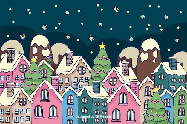 Weihnachtsstadt in der hand gezeichnet Kostenlosen Vektoren