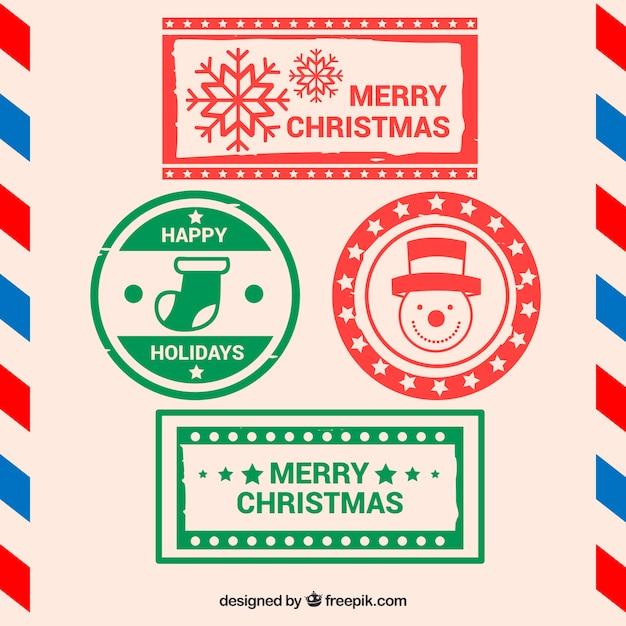 Weihnachtsstempel in rot und grün Kostenlosen Vektoren