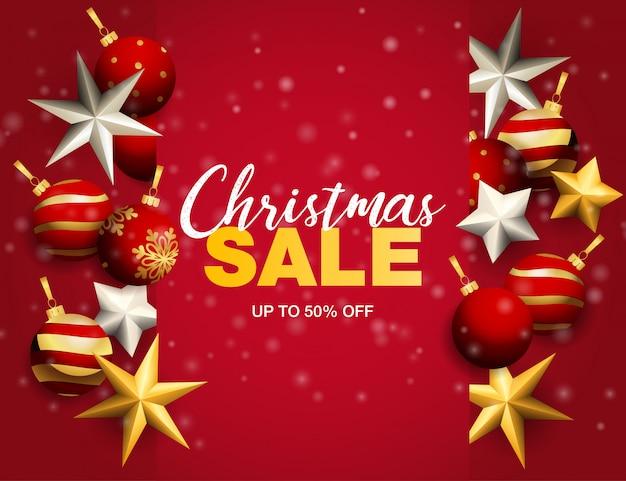 Weihnachtsverkaufsfahne mit bällen und sternen auf rotem grund Kostenlosen Vektoren